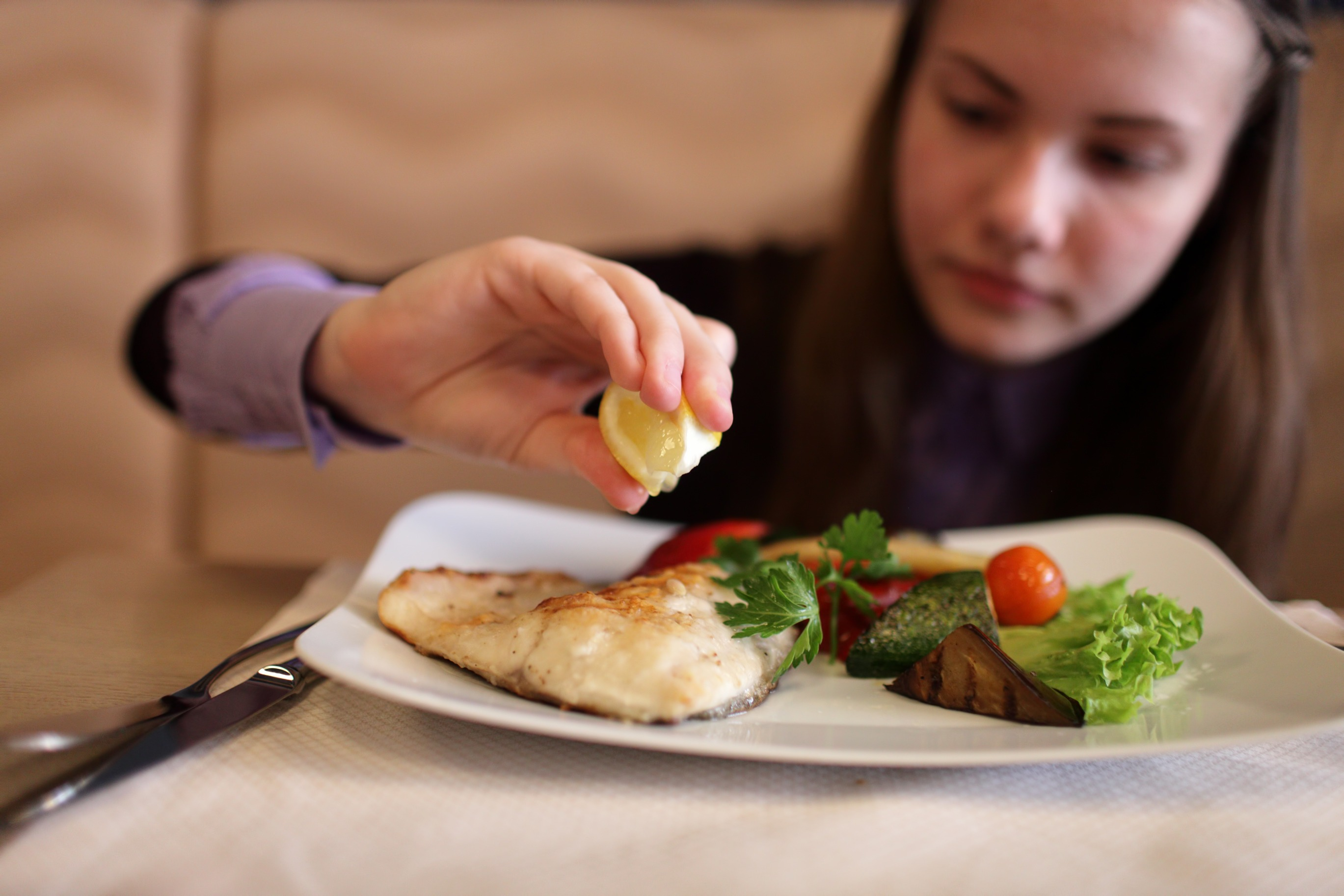 The Teen Has Lunch In A Restaurant